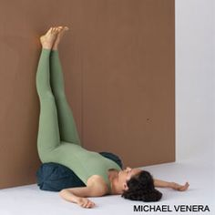 legs up the wall pose - Encourages circulation of blood and lymph from the feet and legs. Bathes the abdomen in fresh blood, stimulating the digestive organs. Soothes the nervous system, allowing your body to shift its attention from warding off stress to daily bodily functions, including detox. Note the pillow/bolster she is using.