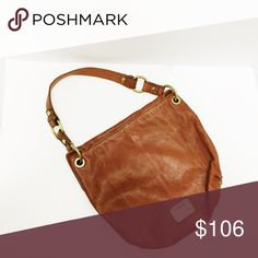 Fossil tan leather saddle flap shoulder bag NWT This item is new with tags and more pics are available upon request. This will make a great holiday gift at a fraction of the price! Depth 11.75 W 2.5 L 12 Fossil Bags Shoulder Bags