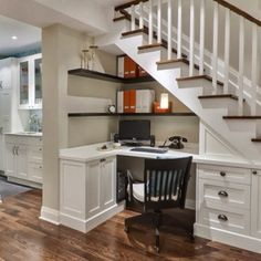 Built-in desk under the stairs.