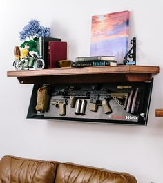 Tactical Walls - Rifle length shelf - folds up! Could also be used for something other than guns.