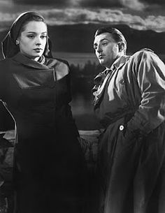 """Jane Greer and Robert Mitchum in """"Out of the Past""""  Kathie Moffat: """"I think we deserve a break."""" Jeff Bailey: """"We deserve each other."""""""