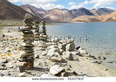 Pangong Tso high altitude mountain lake panorama with Buddhist stupas in forefront (Himalayas, Ladakh, India)