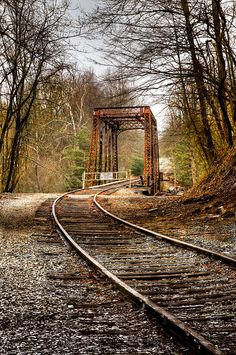 Train Memories is a photograph by Debra and Dave Vanderlaan. The old trestle in Murphy, North Carolina. Source fineartamerica.com