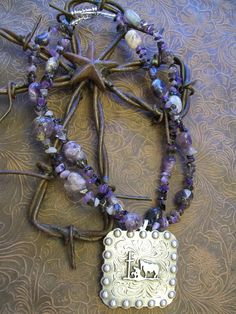 Great purple beaded necklace with large praying cowboy concho pendant. $45