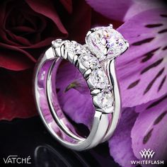 """Slender and elegant, the Vatche """"Caroline"""" Solitaire Engagement Ring is stunning without being overstated. The 4 prong head houses surprise Round-Ideal Diamond Melee that will perfectly compliment your center diamond."""