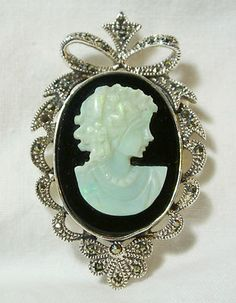 """Vintage STERLING SILVER 925 MARCASITE OPAL CAMEO NECKLACE PENDANT BROOCH 2"""" 16G    Seller information  justinsublime (1652  )    99.9%Positive feedback  Save this seller  See other items     AdChoice  Item condition:Pre-owned  Time left: 6d 19h (Mar 24, 2013 14:37:06 PDT)  Starting bid:US $7.77  [0 bids ]"""