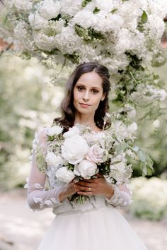 bride holding white bouquet Always Andri Wedding Planner   Designer Beccy Goddard Photography Chelsea Physic Garden Photoshoot
