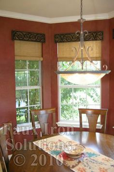 faux wrought iron cornice to cover the top of blinds.
