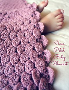 """This beautiful blanket uses a new crochet technique called """"rose petal crochet."""" It is an understated version of a crocodile stitch because it has"""