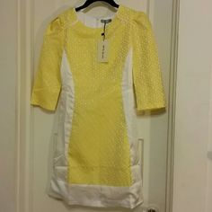 """Beautiful Shift Dress This beautiful shift dress with textured yellow flowers, shiny white fabric, and figure-flattering puffed shoulders has never been worn and comes with the tag still attached. The tag says S, but it fits like an XS and is too tight on me. Lying flat, it measures 13.75"""" at the waist, 16.25"""" at the bust, and 32"""" in length. M&S Dresses Mini"""