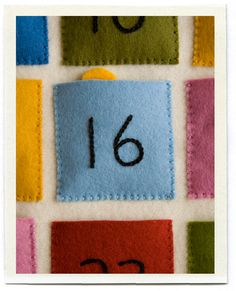 love her squares - used this template: http://www.purlbee.com/the-purl-bee/2008/11/20/embroidered-felt-advent-calendar.html
