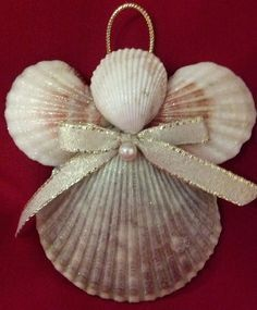 This Seashell Angel Christmas Ornament -Beach Decor - Nautical Holiday Ornament is just one of the custom, handmade pieces you'll find in our ornaments & accents shops.Seashell Engel Ornament Strand-Dekor von CathysCoastCreations (kids arts and craft Seashell Christmas Ornaments, Seashell Ornaments, Nautical Christmas, Christmas Angels, Christmas Diy, Crochet Ornaments, Christmas Poinsettia, Crochet Snowflakes, Crochet Christmas