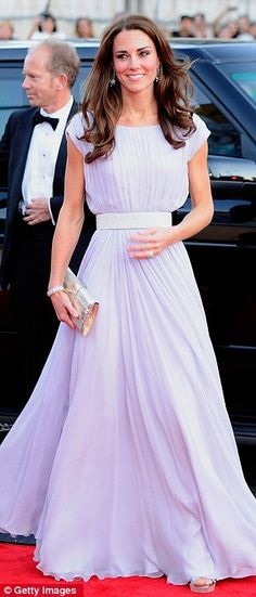 In LA - Sarah Burton Lavender Dress, Jimmy Choo Clutch and shoes. - this colour really suits her - similar to the Jenny Packham hand painted number