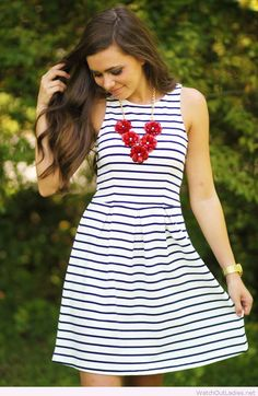 Navy and white dress with red floral necklace