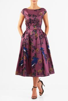 Our floral print polydupioni dress is cinched in with an elasticated self-belt and a wide bow at the back. The princess-seamed bodice and pleated skirt are classically flattering, while pockets and a midi-length hemline offer modern elements.