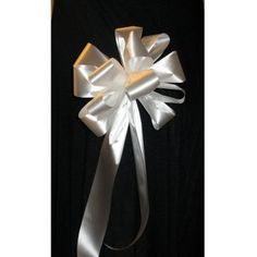 Satin Pew Bows - Step by step photo tutorial plus a list of the supplies you need.