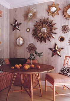 breakfast nook with a collection on the wall- would be great with mexican tin art instead