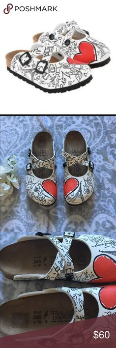 New Listing! Birkis Dorian Valentine An adorable clog with Valentine's design and Paris theme. In white and black print, two half love-heart pieces become one when the feet are placed together. Worn only a handful of times- excellent condition. Size 38. Dual straps that can be crossed. Birkenstock Shoes Mules & Clogs