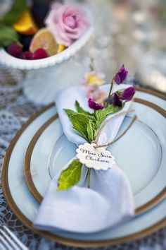 Name tag tied around napkin and flowers