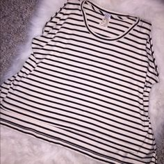 Today Only⭐️NWT Ivory and Black Striped Hi-Lo Top So comfortable and trendy. Hi-Lo design with slits on each side. New with tags and never worn. It is size XS but it a very loose for so anyone from an XS-L can actually fit. Free People Tops