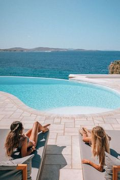 Hanging out on a Greece girls trip. Click here to find the best girls trip destinations in the world. These locations are perfect for a girls weekend getaway and are the best places to go for a girls trip. #girlsgetaway #girlstrip #bachelorette | girls weekend getaway destinations | girls weekend getaway ideas | best places for girls trips | best places for a girls trip | best places to take a girls trip | best places to travel for girls trip | bachelorette party destinations