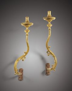 A PAIR OF LARGE GILT-BRONZE ONE LIGHT WALL-APPLIQUES, LOUIS XV, SIGNED AND DATED P. GILLOT À LANGRES, 1733
