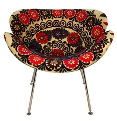 Malia Chair    And for something a little unconventional, how about this embroidered swan-style chair? It's the perfect mix of modern and traditional. It's fantastic to see old-school design made new again.