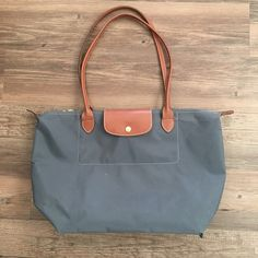 Large Longchamp tote Classic Longchamp Le Pliage tote (large) in the popular Slate color! Pre-loved (small hole in bottom right corner) but still sturdy with plenty of life left! Longchamp Bags Totes