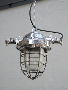 Mirror polished mine lamps. Great small size and powerful presence.  origin: UK  year: 1950