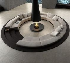 Open fireplaces are awesome looking and warms up a room very well, not like traditional walled fireplaces. This huge roundabout couch is centered by an awesome open fireplace. The couch does look a bit low and the white colored fabric would make it impossible for practical, everyday use.