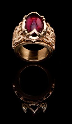 Rubellite Ring  wide band ring set with brilliant round cut white diamonds. J. Chapa Hernandez