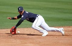 Detroit Tigers shortstop Jose Iglesias dives to field a grounder during the first inning of a spring... - Reinhold Matay/USA TODAY Sports