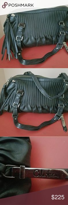 Cole Haan bag Black leather Cole Haan bag, with handles. Hang tag attached. Like new no tears or worn spots. Zippered pocket and two separate pockets inside. Cole Haan Bags Hobos