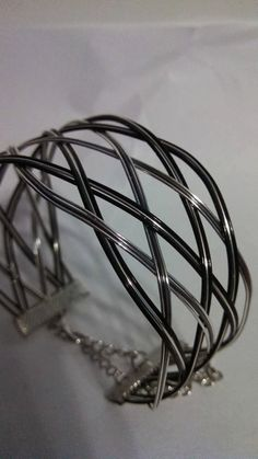 professional looking black and silver open weave bracelet handmade from colored copper wire into a