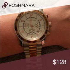 Michael Kors Runway Gold and Silver Watch Oversized gold and silver MK watch. No working battery. Good condition. MICHAEL Michael Kors Accessories Watches