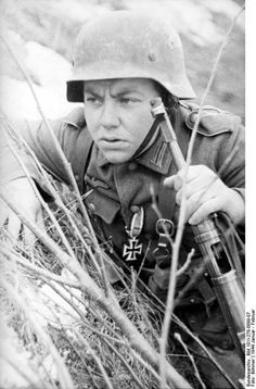 German soldier in the field Russia winter 1944. Note MP 40 submachine gun and Iron Cross 1st Class medal.