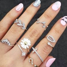 Trending! Multiple rings on fingers.