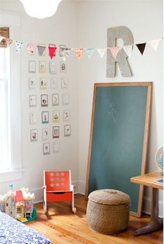 Big chalkboard propped against a kids playroom wall...