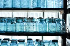 love blue glass, especially these canning jars. Just looking at this makes me happy!