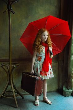 So intriguing. little red riding hood leaving town in the rain? Wish I knew.