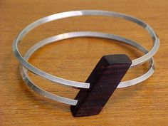 MODERNIST STERLING & WOOD OPTICAL ILLUSION COIL BRACELET