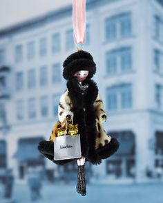 Lady in Faux Leopard Coat Christmas Ornament by De Carlini at Horchow.