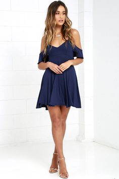 Lulus Exclusive! Get a little flirty with the Lifetime of Love Navy Blue Backless Skater Dress! Ruffled shoulder straps support a darted triangle bodice and frame a low back with lace-up ties. Jersey knit skater skirt has an unforgettable bounce and sway.