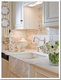 great sink and marble countertops