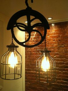 Re-purposed farm well-wheel industrial light. $147.00, via Etsy.