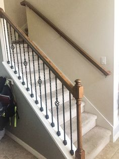 Do you want to paint a stair rail? Do you want an easy project to change your stair rail? The author shares steps and supplies needed to paint a stair rail. Staircase, Staircase Railings, Refinish Staircase, Staircase Design, Wrought Iron Stairs, Stair Railing Makeover, Wrought Iron Stair Railing, Staircase Storage, Wrought Iron Design