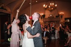 Fun apple eating game played by the bride and groom during their first dance | Lasting Images Photography | villasiena.cc