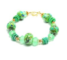 Wild Woman Beads Tipperary lampwork bead bracelet is named in honor of my beloved Amie---my grandfather, born in Scotland---who used to sing this song to us as children. My own trip to Ireland some years ago with my son, who has traveling shoes, was a highlight. It really IS this green there! (Scotland, not so much.)  Made with glorious spring-summer green beads from a variety of glass artists with gold vermeil Bali beads tucked in here and there. Just a lovely chunky bracelet for girls and…