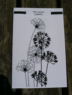 ... the Stampendous Agapanthus Stamp.   The tag is a Spellbinders Label.   I embellshed with black ribbon and black and white rhinestones
