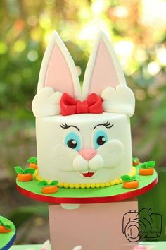 Cute bunny cake at an Easter picnic party! See more party planning ideas at CatchMyParty.com!